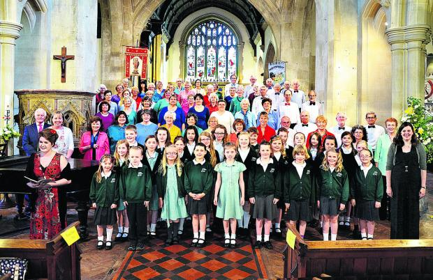 Wiltshire Times: The Athenaeum Singers and Minster School Choir joined forces to present a Spirit of Summer concert at The Minster Church, Warminster, recently. The singers are pictured with soloist Abigail Gostick, front left, conductor Jessi Pywell front right, and acco