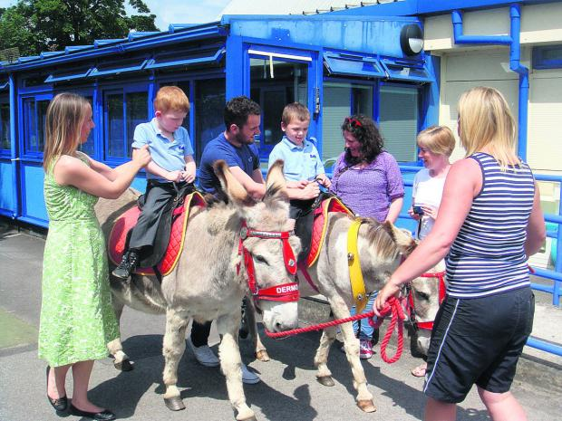 The children from Robins class enjoy a ride around the playground at Larkrise School