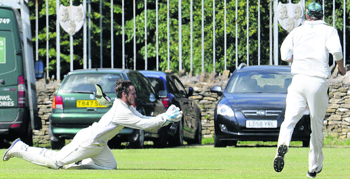 Corsham wicketkeeper Steve Bullen goes full length to take a catch during his side's victory over Frocester on Saturday