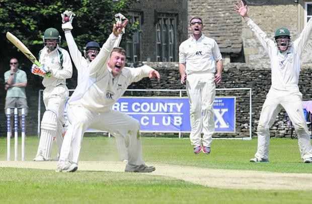 Wiltshire Times: Wiltshire wicketkeeper Adam Miles celebrates the wicket of last Dorset batsman James Hayman which confirmed the home side's victory