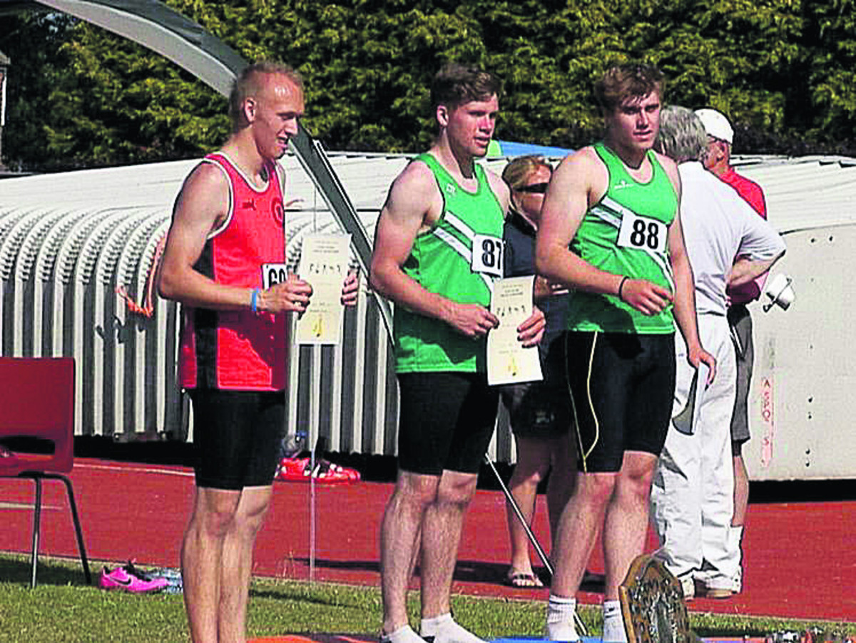 Will Kennedy (centre) on top of the podium in Yeovil