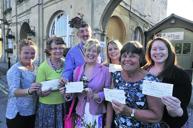 Melksham Rotary Club president Terry Bazeley presenting cheques
