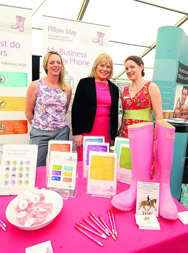 Wiltshire Times: Council leader Jane Scott with Shelley Pritchard and Jessica Pillow from Pillow May chartered accountants