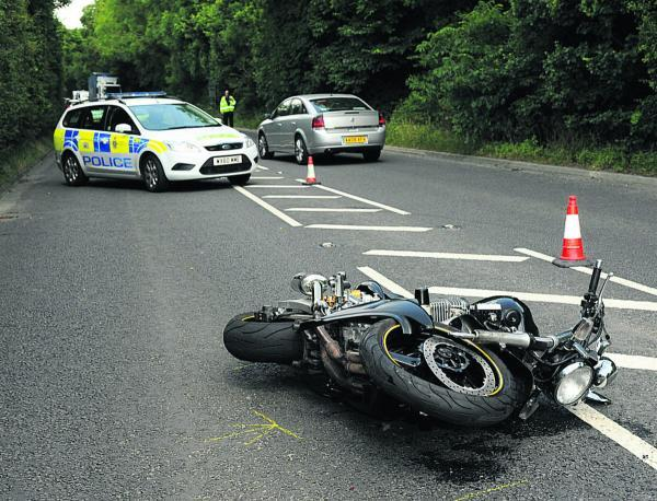The rider of a 1300cc Yamaha XTR was in collision with a car on the A350 near Heywood. Picture by Trevor Porter