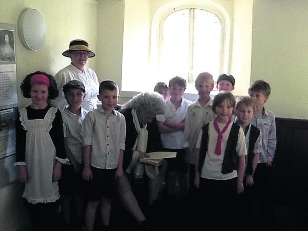 Wiltshire Times: Dressed in pinafores and waistcoats, the pupils looked the part