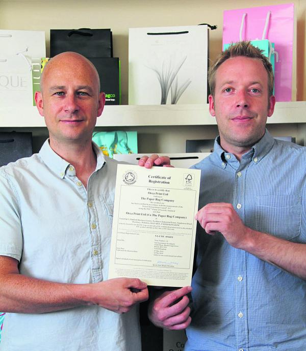 Jon Marling, left, with the certificate and Jim Garven, commercial director of the company