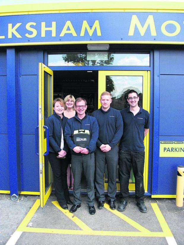 Wiltshire Times: The staff of car spares firm Melksham Motor Spares with the new defibrillator which it has installed