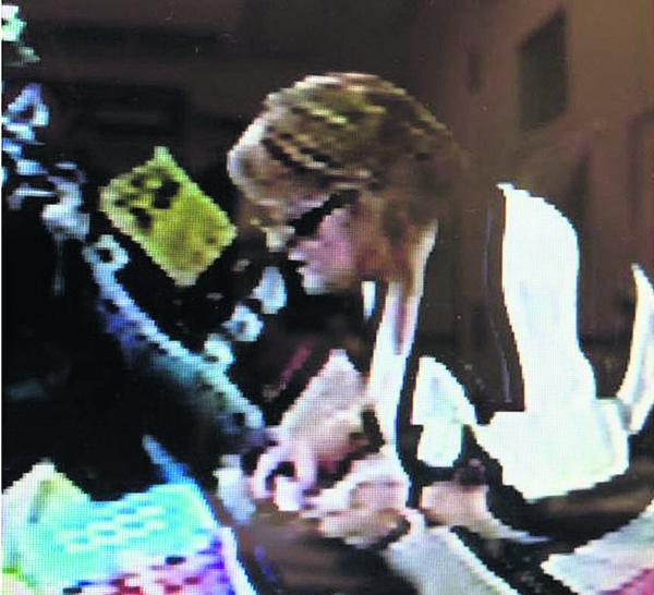 Police want to speak to this woman after the theft of money from a cash machine in Trowbridge
