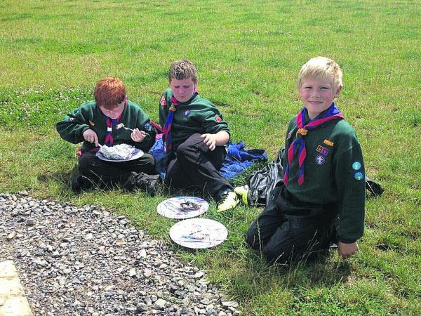 Wiltshire Times: Cubs enjoying their campfire-prepared food at Jubilee Wood