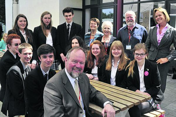 Wiltshire Times: Sir Vincent Fean, front, former British Consul-General in Jerusalem and Ambassador in Libya, with St Augustine's Catholic College Sixth Form students, staff and members of Bradford on Avon Friends