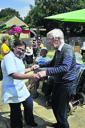 Wingfield Care Home resident Dr Michael Thomas dancing with carer Aziza El-Filali