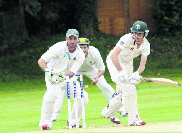 Warminster wicketkeeper Dave Bateman watches as Rockhampton's Guy Brothwood bats