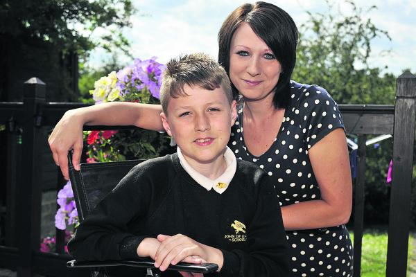 Ashley Gover and his mum Louise are delighted his sight has begun to improve