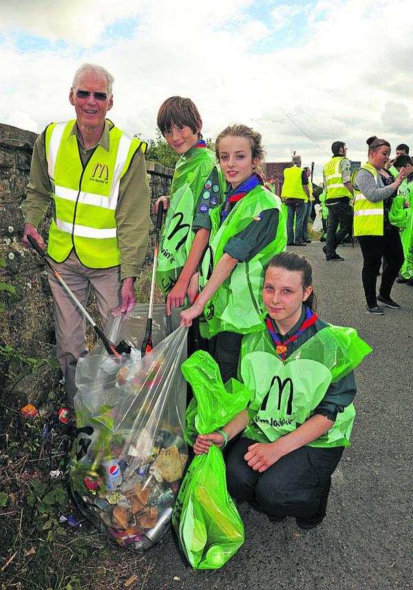 Bob Brice, leader of Trowbridge Town Council, with scouts Niall, Emma and Sophie clean up