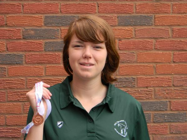 Emily Hutchinson, with her English Schools bronze medal