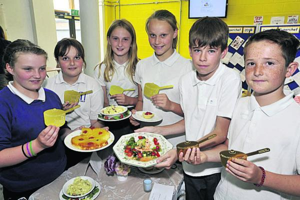 Winners of the masterchef contest Leah Webb and Melissa Gould, centre, from Forest and Sandridge Primary School, with runners up Ella Miles and Elle Snell from Manor Primary School and Callum McMillan and Oliver Spooner from Bowerhill Primary