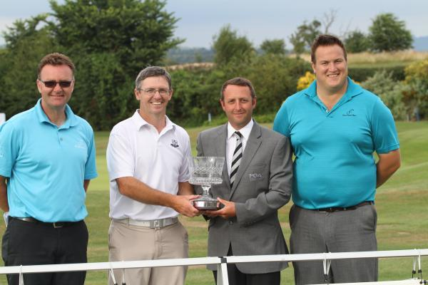 Winner Richard Dinsdale and tournament controller Tom Sheffield with the trophy flanked by Cumberwell director of golf John Jacobs (left) and general manager Ali James