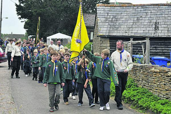 Broughton Gifford and Holt Scouts make their way through the village on Sunday