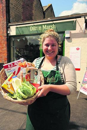 Ellie Whitehead at the Dilton Marsh Shop now reopened complete with Post Office