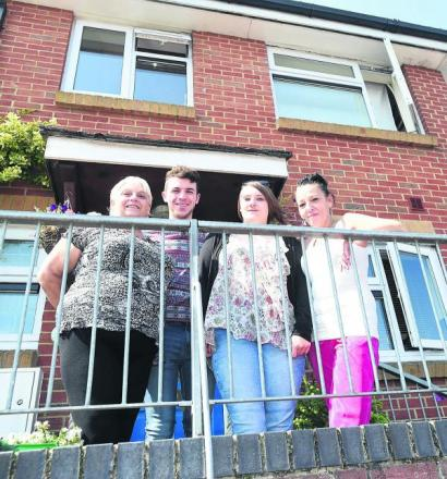 Jennifer Lyons, right, outside her home with neighbours Stella Clack, Jake Gibbs and Chelsea Clack. Picture by Diane Vose