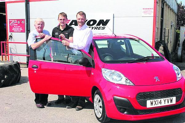 Colin and James Love hand the keys to a new Peugeot 107 to Simon Bridgford-Whittick