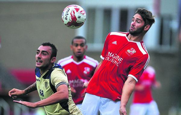 Wiltshire's Jordan Turnbull (right) featured for Swindon Town against Leeds United on Tuesday