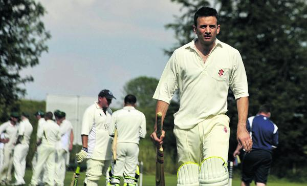 Avebury's Richard Hughes walks after being dismissed against Beehive, below Beehive's Ben Clift turns his arm over