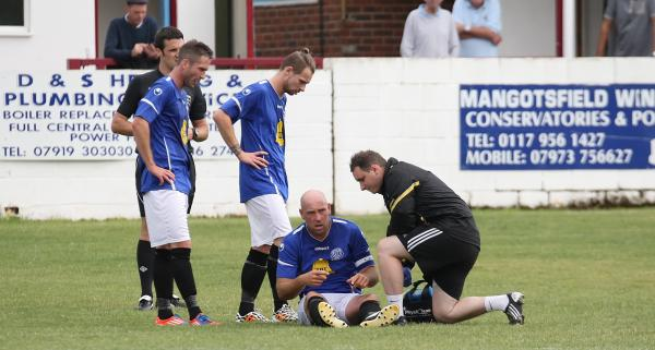 Striker Alan Griffin is treated for a thigh injury that forced him off in today's friendly (Picture by Robin Foster)