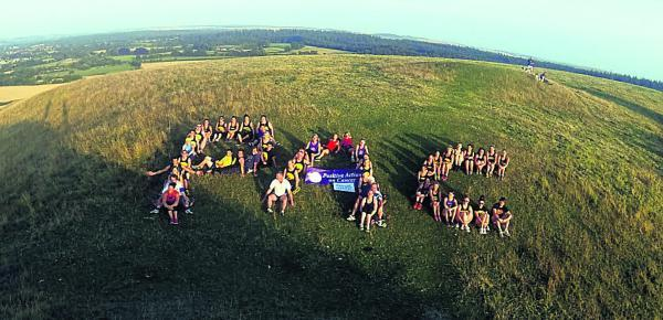 Fundraisers on Cley Hill after completing their gruelling 5km challenge for Frome charity Positive Action on Cancer