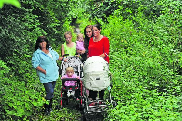 Cilla Mountstephens, left, with members of her family on the  footpath which leads to Warminster Cemetery where she has six graves she tends