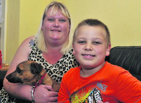 Jacob Law, seven, with his mum Joanne Gifford.   Photo: Glenn Phillips (49649)