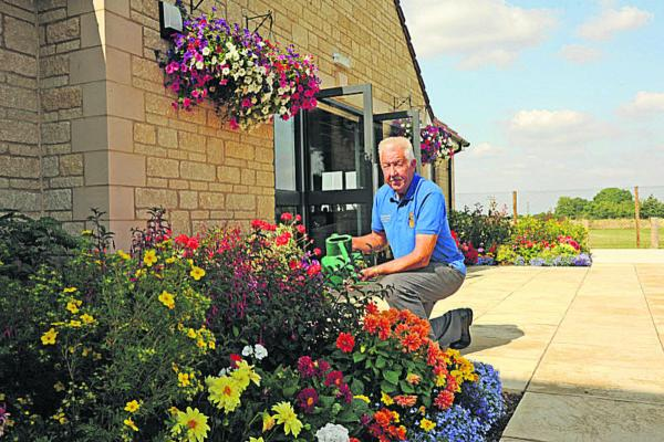Ian Lawes tending to the floral display at the Trowbridge Rugby Club