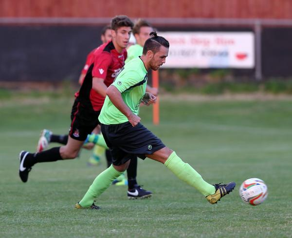 Debutant Zac Evans gets on the ball during Chippenham Town's 2-1 loss at Redditch United last night