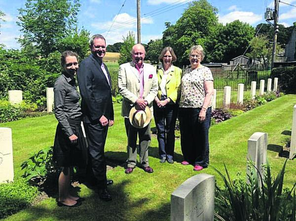 Ceilidh Dunphy and Rob Taylor, David Shaw, Jane Thomas and Barbara Saunt in the War Graves cemetery in Codford