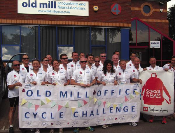 Staff from Old Mill wave off the cycle challengers from their offices in Melksham at the start of the trek