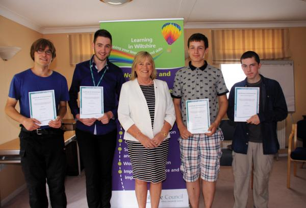 Wiltshire Council leader Jane Scott with trainees James Bailey, left, Joshua Barton, William Bridger and Connor Devlin