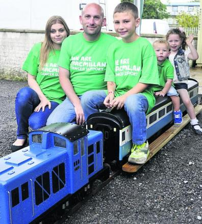 Naomi Jordan, Jason Pym, driver Samuel Pym, aged 10, and pasengers Koel Vowles and Sienna Jones on the Pyms' 0-6-0 gauge electric model diesel engine at summer fete at Westbury in aid of Macmillan Cancer Support. Picture by Glenn Phillips