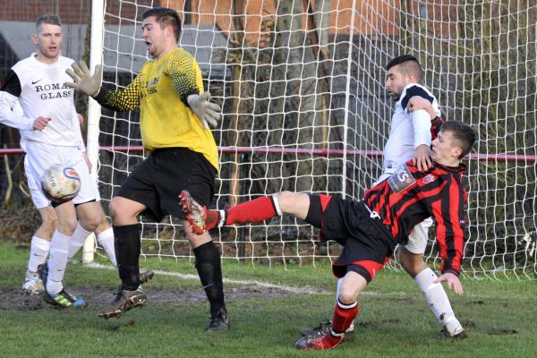 Jack Miluk (red and black) scored in Warminster Town's midweek win over OIdland Abbotonians