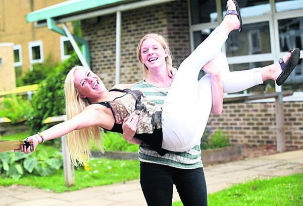 Issie Forrest and Leanne Bookman celebrate getting the grades they wanted at Sheldon School, Chippenham,