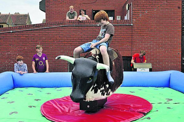 Alex Melville riding the bucking bull