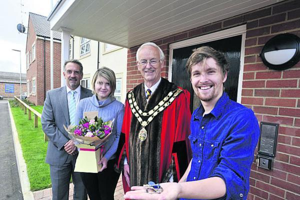 Trowbridge mayor Glyn Bridges at the Centenary Court development with residents Marcus Gobby, right, and Victoria Challis-Gobby, and Gerraint Oakley of Curo Homes. Picture by Glenn Phillips (49667)