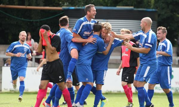 Alex Ferguson is mobbed after scoring Chippenham Town's opener on Saturday (Picture by Robin Foster)