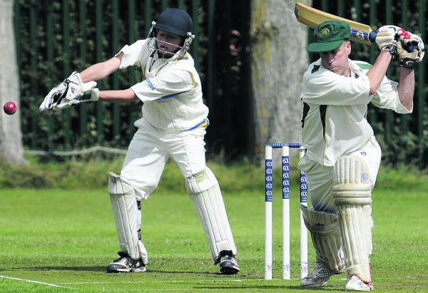 Beehive (Southwick) batsman James Hall and Potterne 3rd wicketkeeper George Elliott during their Division Three clash