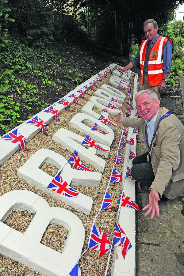 Mayor John Potter with Simon Meade King who made  new concrete sign at Bradford on Avon Station