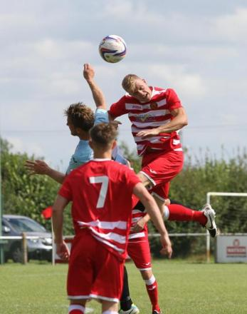 Corsham Town's Matt Jenkins gets up for the ball during last weekend's FA Cup loss to Horndean (Picture: John Cuthbertson)