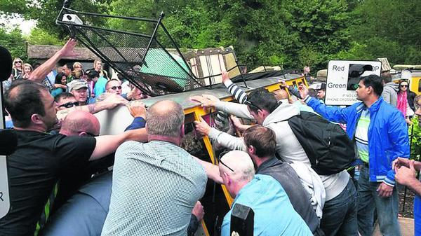 Onlookers rush to help as the Longleat train topples over. Three people were hurt, one seriously, in Wednesday's accident     Photo by Lisa Mowe