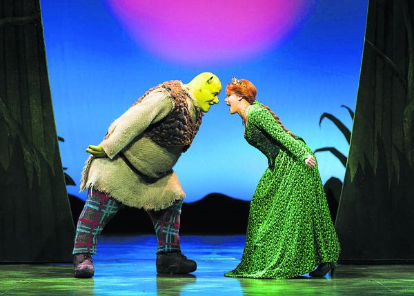 Dean Chisnall as Shrek and Faye Brookes as Princess Fiona in Shrek the Musical. 	                           Photo: Helen Maybanks