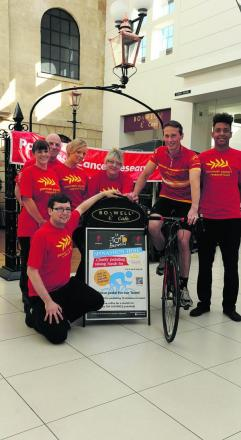 Boswell manager Harrison Carter, director Matt Burn on his bike and staff in promoting their spinathon
