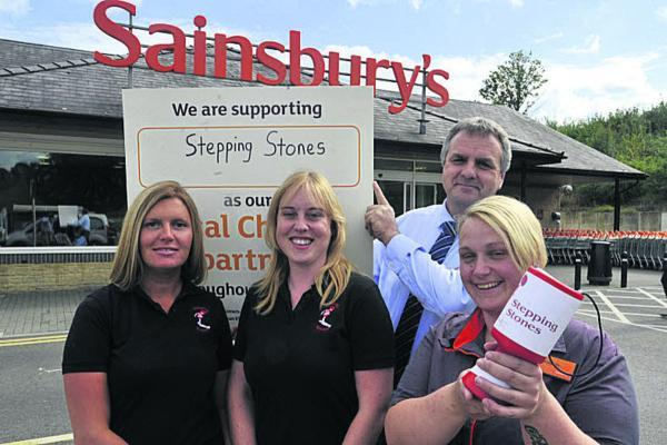 Sainsbury's Bradford on Avon manager Neil Laver with colleague Bridgette Humm, front, whose son has benefited from the charity, and Teresa Blake, left, and Sarah Cottle from Stepping Stones