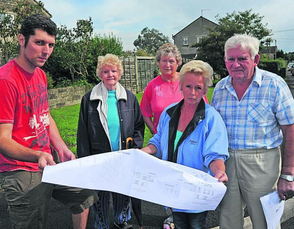 Lee Davis and Shirley Sloper hold plans for the two homes planned along with fellow Marshmead residents angry at the proposal. Picture by Trevor Porter
